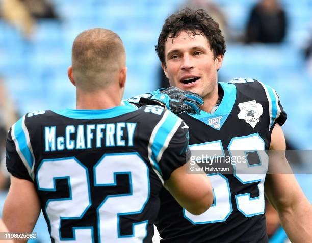 Christian McCaffrey and Luke Kuechly of the Carolina Panthers warms up during their game against the New Orleans Saints at Bank of America Stadium on...