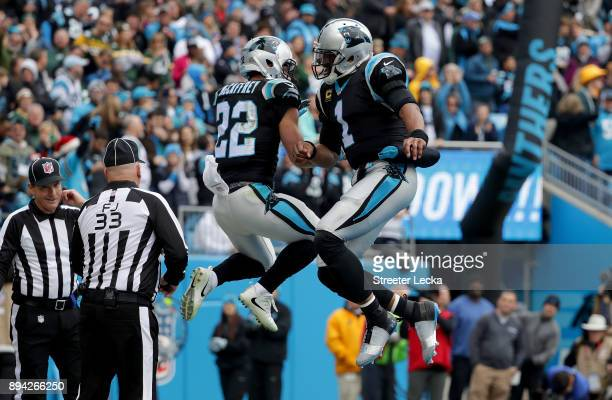 Christian McCaffrey celebrates with teammate Cam Newton of the Carolina Panthers after a touchdown against the Green Bay Packers in the first quarter...