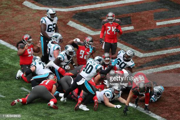 Christian McCaffrey of Carolina Panthers scores his sides first touch down of the game the NFL game between Carolina Panthers and Tampa Bay...