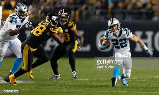 Christian McCaffrey of the Carolina Panthers carries the ball against Vince Williams of the Pittsburgh Steelers during the first half in the game at...