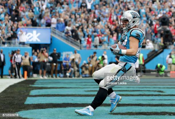 Christian McCaffrey of the Carolina Panthers celebrates a touchdown against the Atlanta Falcons in the second quarter during their game at Bank of...