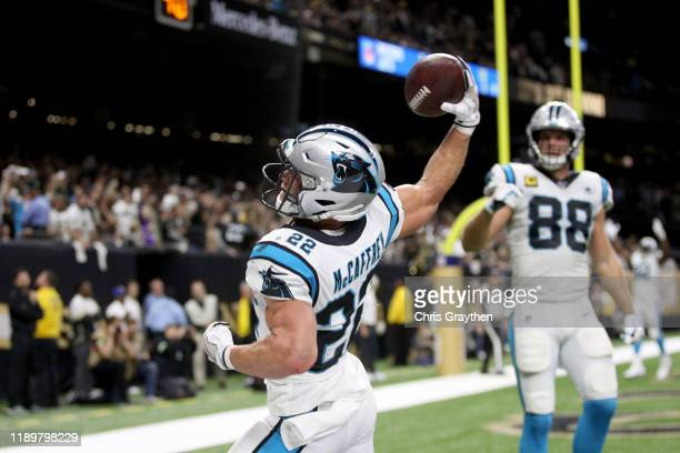 Christian McCaffrey of the Carolina Panthers celebrates after scoring a 1 yard touchdown against the New Orleans Saints during the second quarter in...