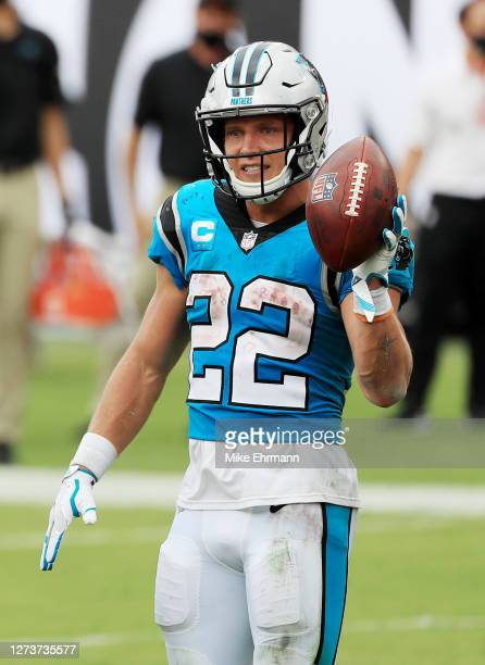 Christian McCaffrey of the Carolina Panthers celebrates after scoring a touchdown during the third quarter against the Tampa Bay Buccaneers at...