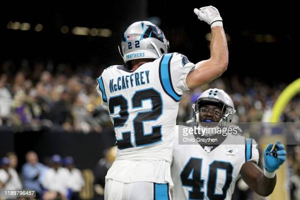 Christian McCaffrey of the Carolina Panthers celebrates with his teammate Alex Armah after scoring a 1 yard touchdown against the New Orleans Saints...