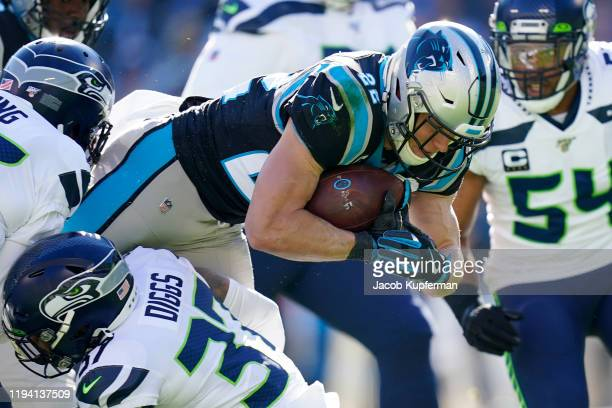 Christian McCaffrey of the Carolina Panthers is brought down by Quandre Diggs of the Seattle Seahawks during the first quarter during their game at...