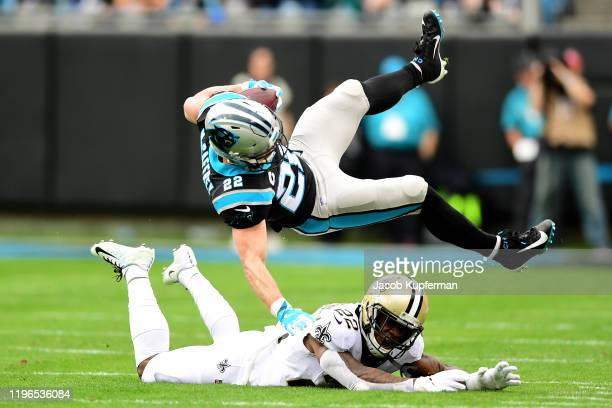 Christian McCaffrey of the Carolina Panthers is brought down by Chauncey Gardner-Johnson of the New Orleans Saints during the first quarter during...