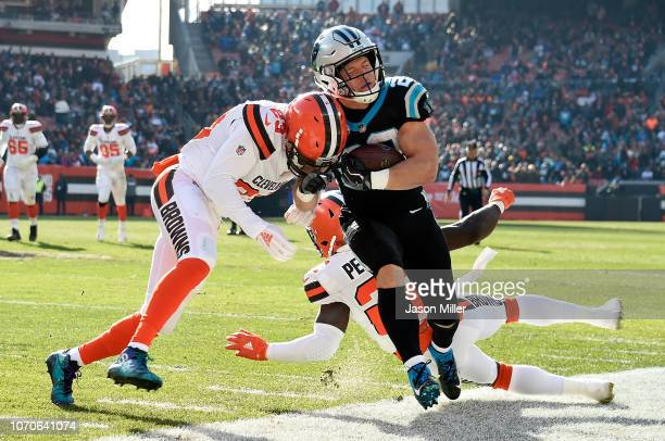Christian McCaffrey of the Carolina Panthers is pushed out of bounds by Damarious Randall of the Cleveland Browns during the first quarter at...
