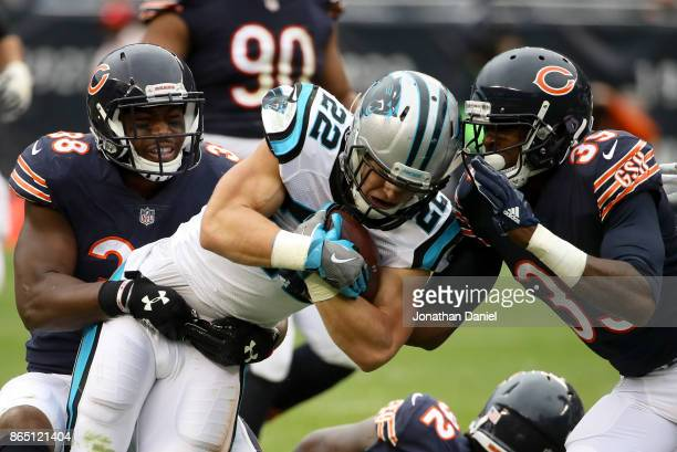 Christian McCaffrey of the Carolina Panthers is tackled by Adrian Amos of the Chicago Bears in the third quarter at Soldier Field on October 22 2017...