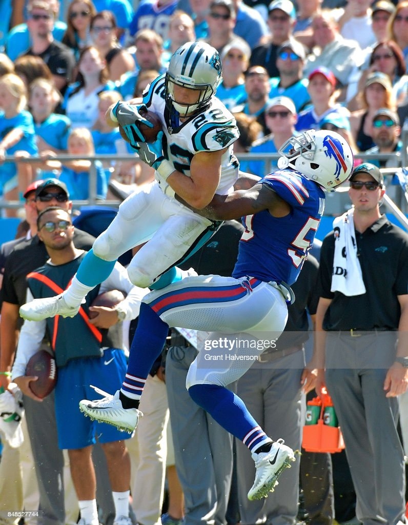 Christian McCaffrey #22 of the Carolina Panthers makes a catch against Ramon Humber #50 of the Buffalo Bills during their game at Bank of America Stadium on September 17, 2017 in Charlotte, North Carolina.