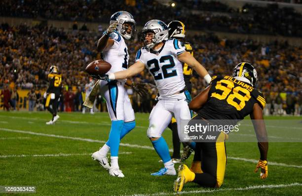 Christian McCaffrey of the Carolina Panthers reacts after a 20 yard touchdown reception during the first quarter in the game against the Pittsburgh...