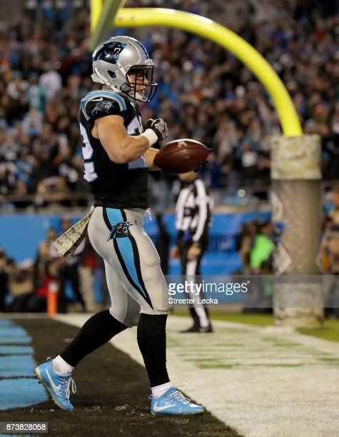 Christian McCaffrey of the Carolina Panthers reacts after a touchdown against the Miami Dolphins in the second quarter during their game at Bank of...