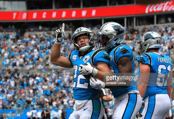 Christian McCaffrey of the Carolina Panthers reacts after scoring a touchdown against the Jacksonville Jaguars during their game at Bank of America...