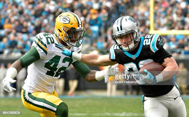 Christian McCaffrey of the Carolina Panthers runs against Aaron Ripkowski of the Green Bay Packers during their game at Bank of America Stadium on...