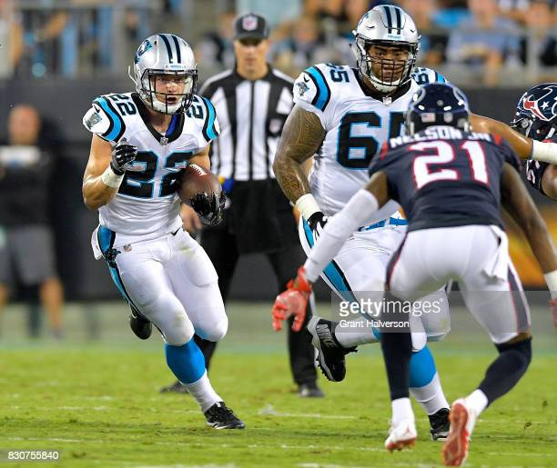 Christian McCaffrey of the Carolina Panthers runs against the Houston Texans during their game at Bank of America Stadium on August 9 2017 in...