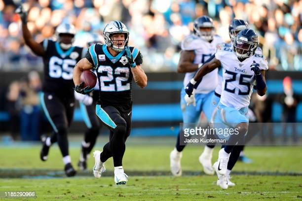 Christian McCaffrey of the Carolina Panthers runs for a touchdown in the fourth quarter during their game against the Tennessee Titans at Bank of...