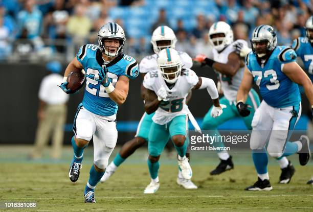 Christian McCaffrey of the Carolina Panthers runs for a touchdown against the Miami Dolphins in the first quarter during the game at Bank of America...