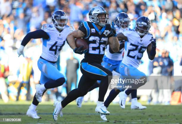 Christian McCaffrey of the Carolina Panthers runs for a touchdown against the Tennessee Titans during their game at Bank of America Stadium on...