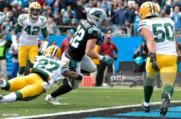 Christian McCaffrey of the Carolina Panthers runs for a touchdown against the Green Bay Packers in the first quarter during their game at Bank of...