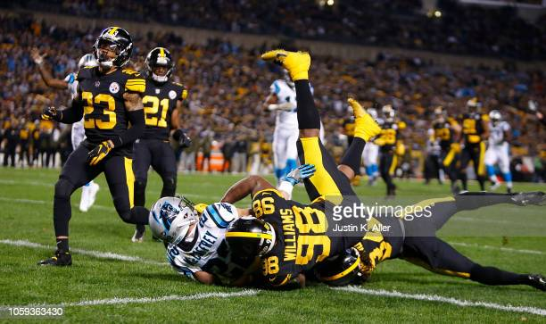 Christian McCaffrey of the Carolina Panthers runs into the end zone for a 20 yard touchdown reception during the first quarter in the game against...