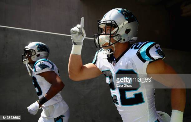Christian McCaffrey of the Carolina Panthers runs on to the field to warm up before their game against the San Francisco 49ers at Levi's Stadium on...