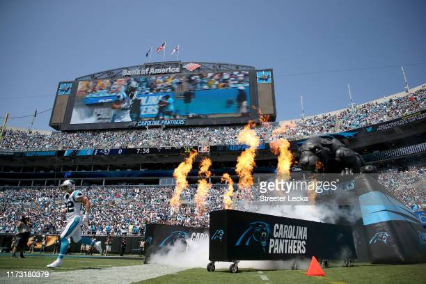 Christian McCaffrey of the Carolina Panthers runs onto the field during player introductions before their game against the Los Angeles Rams at Bank...