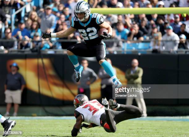 Christian McCaffrey of the Carolina Panthers runs the ball against Carlton Davis of the Tampa Bay Buccaneers in the first quarter during their game...
