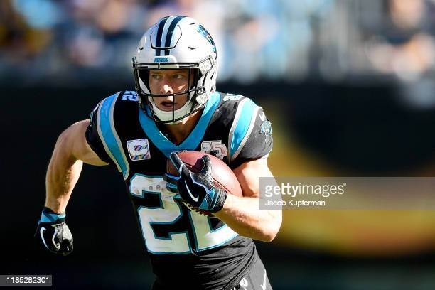 Christian McCaffrey of the Carolina Panthers runs with the ball in the second quarter during their game against the Tennessee Titans at Bank of...