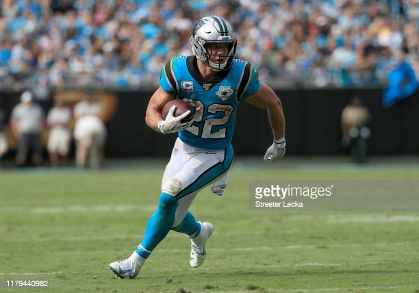 Christian McCaffrey of the Carolina Panthers runs with the ball against the Jacksonville Jaguars during their game at Bank of America Stadium on...