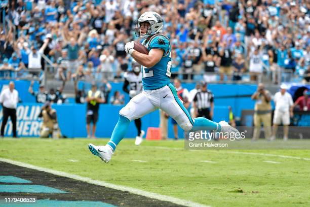 Christian McCaffrey of the Carolina Panthers scores a touchdown during the first quarter of their game against the Jacksonville Jaguars at Bank of...