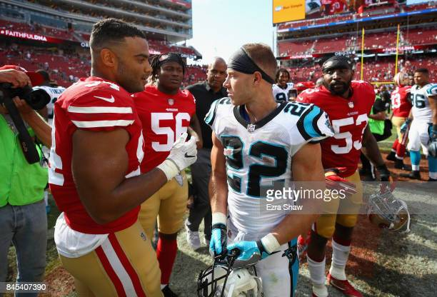 Christian McCaffrey of the Carolina Panthers talks to Reuben Foster and Solomon Thomas of the San Francisco 49ers after their game at Levi's Stadium...