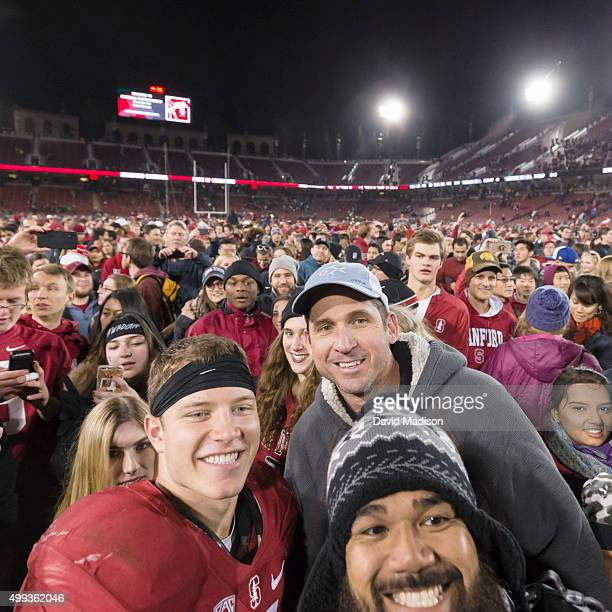 Christian McCaffrey of the Stanford Cardinal and his father Ed McCaffrey a former Stanford and NFL wide receiver pose for a fan photo following an...