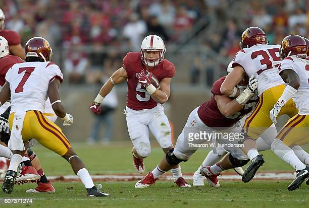 Christian McCaffrey of the Stanford Cardinal carries the ball against the USC Trojans during the first half of their NCAA football game at Stanford...