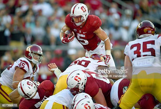 Christian McCaffrey of the Stanford Cardinal dives over the top for no gain at the one yard line against the USC Trojans during the first half of...