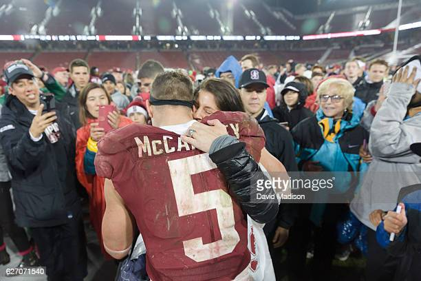 Christian McCaffrey of the Stanford Cardinal is greeted by his mother Lisa McCaffrey following an NCAA football game against the Rice Owls played on...