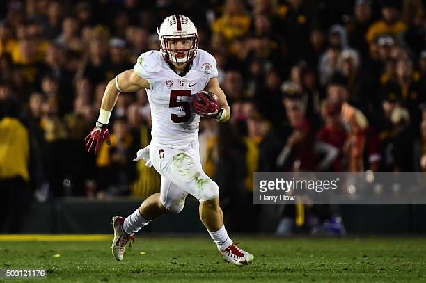 Christian McCaffrey of the Stanford Cardinal runs with the ball in the second half against the Iowa Hawkeyes in the 102nd Rose Bowl Game on January 1...