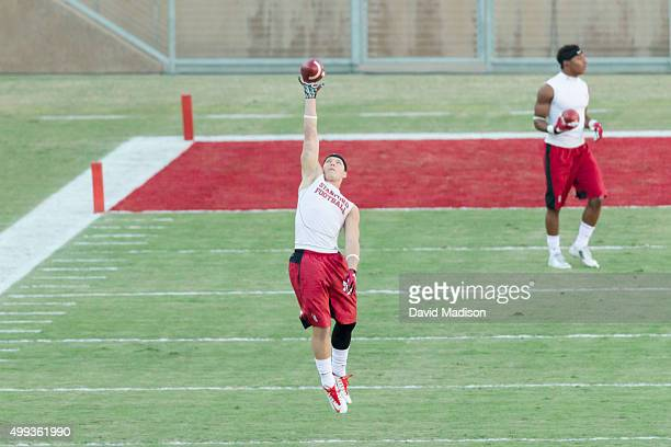 Christian McCaffrey of the Stanford Cardinal warms up before an NCAA football game against the Notre Dame Fighting Irish on November 28 2015 at...