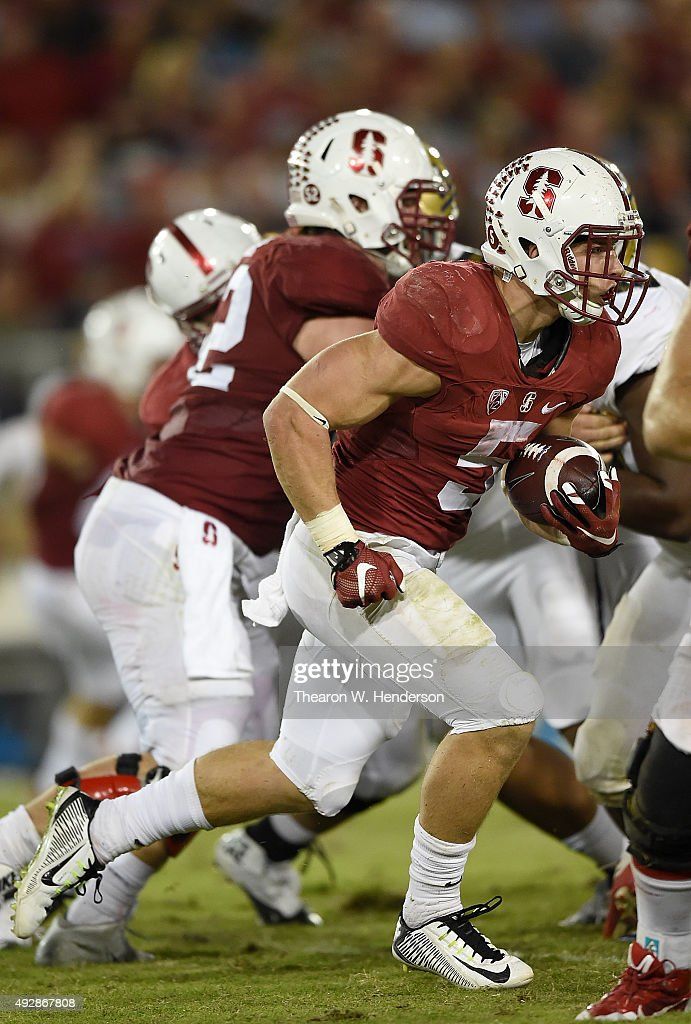 Christian McCaffrey #5 of the Stanford Cardinal's rushes for a seventy yard touchdown run against the UCLA Bruins in the third quarter of an NCAA football game at Stanford Stadium on October 15, 2015 in Stanford, California.