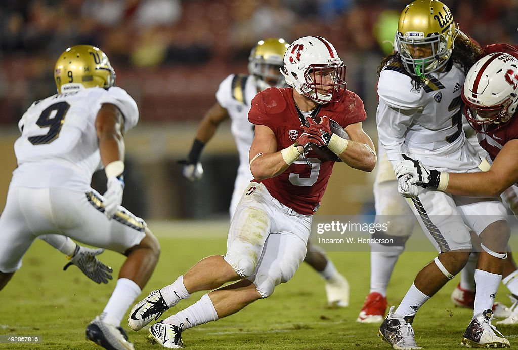 Christian McCaffrey #5 of the Stanford Cardinal's rushes with the ball against the UCLA Bruins in the third quarter of an NCAA football game at Stanford Stadium on October 15, 2015 in Stanford, California.