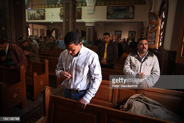Christian men attend a service in Saint Mark Coptic Orthodox Church in Giza on November 27 2011 in Greater Cairo Egypt There are an estimated 10...