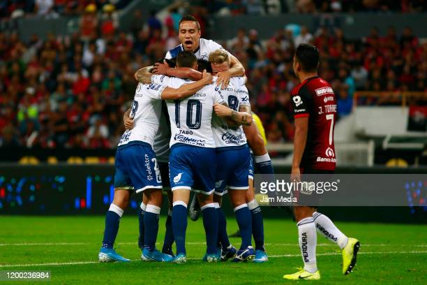 Christian Menendez of Puebla celebrates with teammates after scoring the first goal of his team during the 2nd round match between Atlas and Puebla...