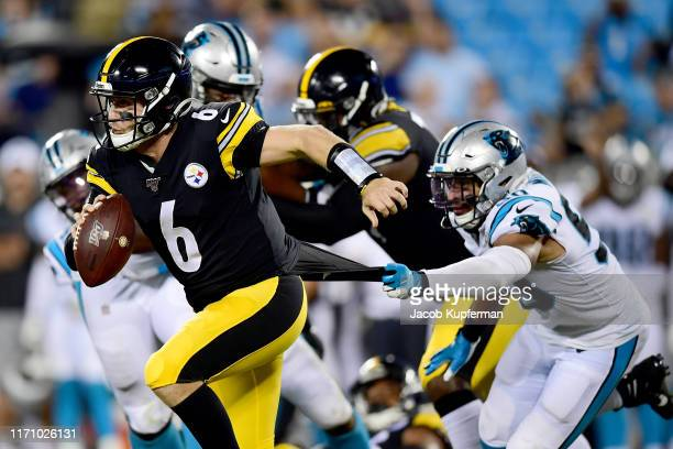 Christian Miller of the Carolina Panthers sacks Devlin Hodges of the Pittsburgh Steelers during their preseason game at Bank of America Stadium on...