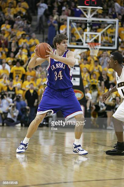 Christian Moody of the Kansas Jayhawks looks to pass the ball against the Missouri Tigers on January 16,2006 at Mizzou Arena in Columbia, Missouri....