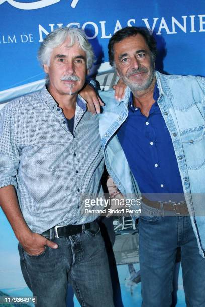 Christian Moullec and Nicolas Vanier attend the DonneMoi Des Ailes Premiere At Cinema UGC Normandie on October 06 2019 in Paris France