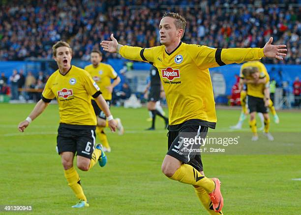 Christian Mueller and Tom Schuetz of Bielefeld celebrate their teams first goal in front of the Bielefeld supporters during the Second Bundesliga...