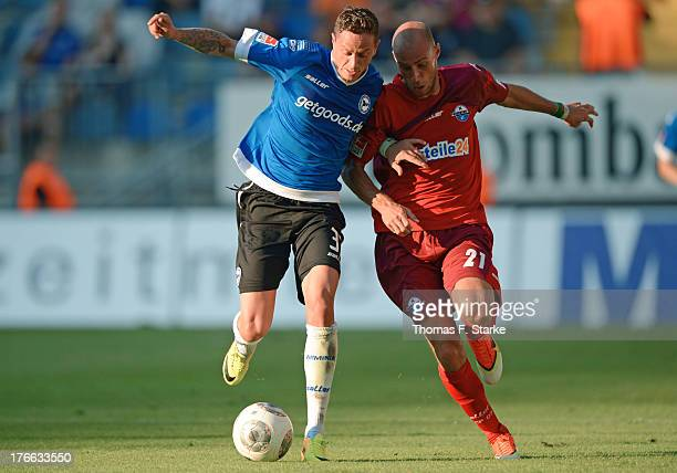 Christian Mueller of Bielefeld and Daniel Brueckner of Paderborn fight for the ball during the Second Bundesliga match between Arminia Bielefeld and...