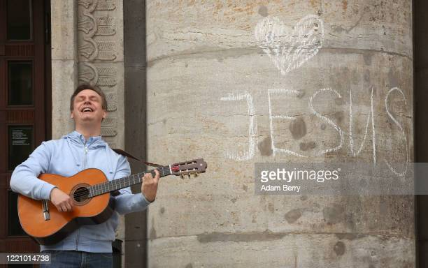 Christian musician performs as protesters demonstrate against restrictions on public life designed to stem the spread of the coronavirus, or...
