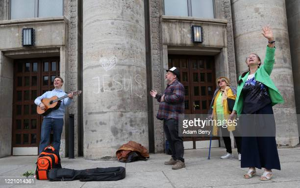 Christian musicians perform as protesters demonstrate against restrictions on public life designed to stem the spread of the coronavirus, or...
