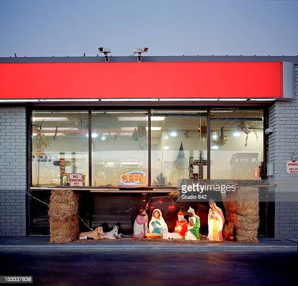 christian nativity in front of store - convenience store stock photos and pictures