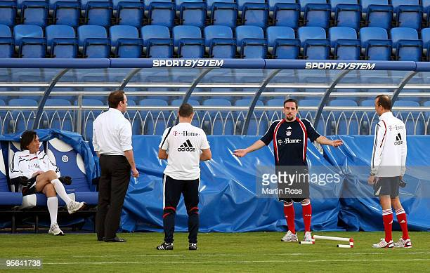 Christian Nerlinger manager of Bayern Muenchen speaks to Franck Ribery during the FC Bayern Muenchen training session at the Al Nasr training ground...
