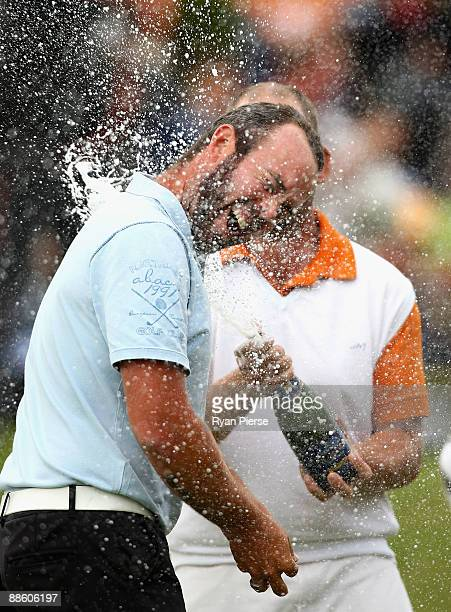 Christian Nilsson of Sweden is sprayed with champagne after winning the Open de St Omer at the AA St Omer Golf Club on June 21 2009 in St Omer France